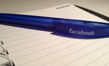 Facebook 6 pen on notebook