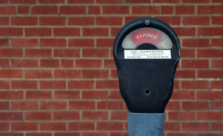 Parking meter and wall